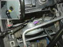 In order to gain access to the linkage that connects the brake pedal to the booster actuator, you need to remove the alarm horn (purple arrow).