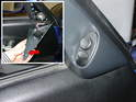The mirror switch simply pops out of the door panel plastic trim piece.