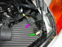 Don't forget to plug the new wiring harness from the new rear wing (purple arrow) into the connector in the engine bay (green arrow).