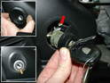 To remove the ignition key cylinder, first begin by pulling out the rubber ignition switch surround (upper left).