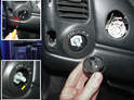 Remove the headlamp knob by pressing on the release tab and then pulling off the knob (red arrow, upper left).