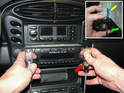 Use the radio removal keys (available direct from Becker and also supplied with the factory kit, green arrow) to pull out the radio by inserting them into the head unit and pulling on the two keys using two screwdrivers.