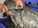 Remove the 8mm Allen plug in the top of the transmission.
