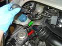 Next, remove the intake boot (red arrow) by loosening the 7mm hose clamp screw (green arrow) with a 7mm nut driver or flat blade screwdriver and pulling the boot off of the intake plenum.