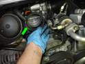 Remove the rubber boot (green arrow) from the throttle body.