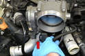 Disconnect the harness from the throttle body (red arrow).
