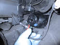 Plug the electrical connector into the new bulb and install it into the fog light lens.
