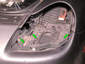 Shown here are the rails that guide the headlight assembly in place once installed (green arrows).