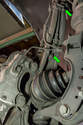 Rotate the front strut outward as much as possible so you can access the brake line bracket.