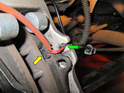 Now take the new brake wear sensor and press the plastic tab into the tab on each brake pad (yellow arrow).