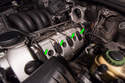 Once the coil pack cover is removed, you can see all four coil packs (green arrows) on the right side of the engine.