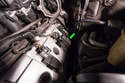 Carefully pull the coil pack up and out of the cylinder head (green arrow).