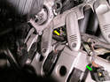 Take care when removing the coil pack cover from the left side of the engine.