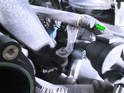 The other method for relieving fuel pressure involves removing the two plastic caps off each end of the fuel rail and using a pin to press the Schrader valve in.