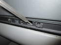 If your glove box is stuck closed, you'll need to insert a small drift or screwdriver in the center hole below the trim strip as shown here.