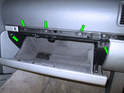 Once the glove box is open, remove the five T20 Torx screws shown here (green arrows).