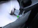 Press the tab on the electrical connector (green arrow) and pull it out of the mirror switch.