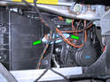 Shown here is the location of the blower fan regulator directly behind the glove box assembly.