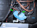 Press the small plastic tabs on each plug in and remove both plugs (green arrows) from the regulator.
