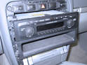 Carefully pull the stereo out from the dash with the lower tray attached.