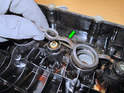 Now remove the gaskets from the spark plug holes (green arrows).