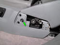 Remove the T25 Torx screw underneath (green arrow).