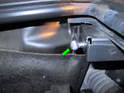 Clean and lubricate the lower ball pivot with a dab of white moly grease (green arrow).