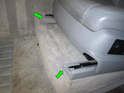 Pull both front covers off the seat rails (green arrows).