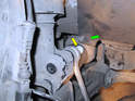 You'll find that the upper connection has a very long bolt running through the end link and the front strut (yellow arrow).