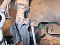 ThisPicture shows the liner (green arrow) up and over the end link as we pull the bolt out.