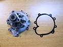 Shown here is a new water pump and gasket for your Porsche Cayenne.
