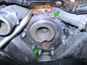 Check that the two dowel pins are still in the engine (green arrows) and check that the mounting surface for the pump is clean.