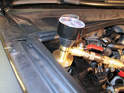 Once the pump is installed, reattach the radiator hoses.