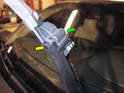 Pull each wiper arm up so that you can pull the blade assembly (green arrow) off the pivot rod (yellow arrow).