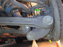 Begin by removing the sway bar end link (green arrow).