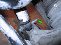 Now remove the bolt holding the shock absorber in place (green arrow) and separate the wheel hub from the shock absorber.