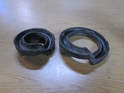 Pull the rubber spring mounts off the upper and lower collars and inspect them for wear or cracks.