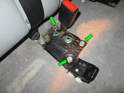 You'll need to loosen and remove the three 10mm XZN bolts (green arrows) holding the right seat belt bracket to the floor.