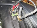 Attach the negative side of the jumper cables to the negative post on the car with the good battery.