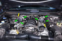 Both Left and Right Sides - Begin by removing the six T40 Torx screws (green arrows) that hold the secondary air pumps to the brackets mounted above the cylinder heads.