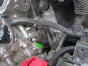 Left and Right Sides of Engine: Shown here is the E10 Torx bolt holding each cam sensor in place (green arrow).