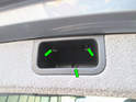Remove the three T30 Torx screws (green arrows) holding the pull handle to the hatch frame.