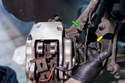 Front Brake Calipers - Press the tab on the electrical connector (green arrow) and pull the brake wear sensor plug (yellow arrow) off.