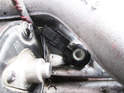 Shown here is the knock sensor on the left side of the engine under the coolant tube.