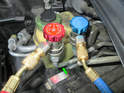 If you are using a set of air conditioning manifold gauges, connect the low and high side pressure hoses to each port.