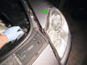 To eject the headlight assembly, you'll need to turn the tool counter-clockwise on the left side headlight as shown here (green arrow), or clockwise on the right side headlight.