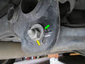 Toe Control Link: Loosen and remove the 18mm nut and bolt holding the toe control link to the sub frame.