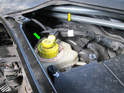 Shown here is both the master cylinder reservoir (green arrow) and brake booster (yellow arrow) on the Porsche Cayenne.