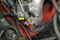 The fuel line (yellow arrow) attaches to the top of the injector (red arrow).