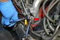 If you have the metal lines it is OK to use the connection point to gently pull the injector out; if you have the plastic lines do not attempt this as they get brittle over the years and can crack.